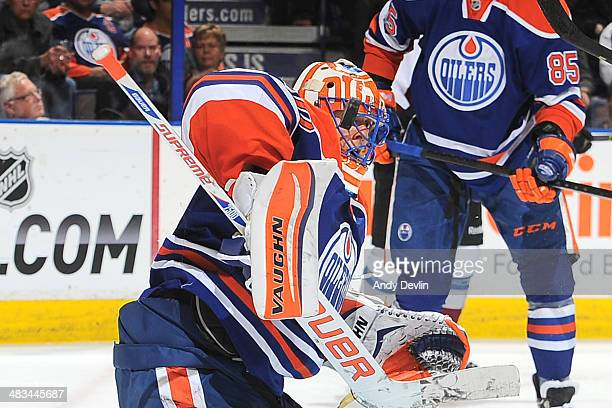 Ben Scrivens of the Edmonton Oilers makes a save in a game against the Colorado Avalanche on April 8 2014 at Rexall Place in Edmonton Alberta Canada