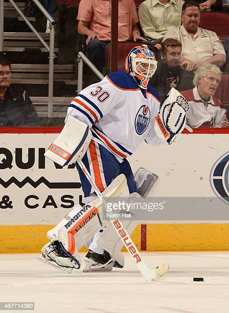 Ben Scrivens of the Edmonton Oilers plays the puck up ice against the Arizona Coyotes at Gila River Arena on October 15 2014 in Glendale Arizona