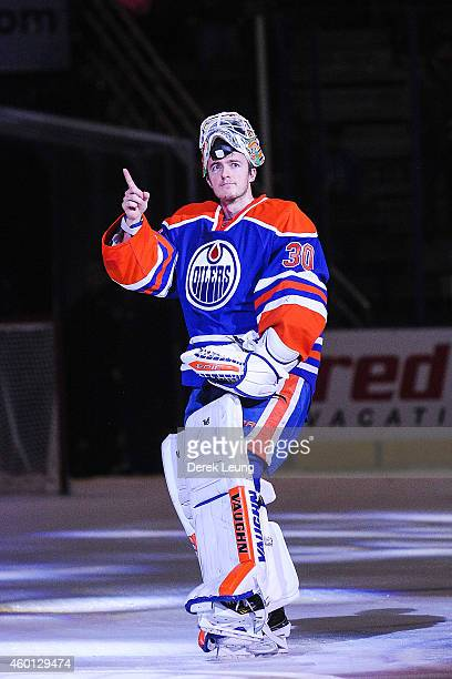 Ben Scrivens of the Edmonton Oilers salutes the crowd after earning the first star of the night after defeating the San Jose Sharks at Rexall Place...