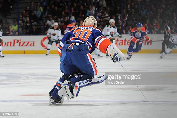 Ben Scrivens of the Edmonton Oilers skates to the bench in a game against the Minnesota Wild on February 27 2014 at Rexall Place in Edmonton Alberta...