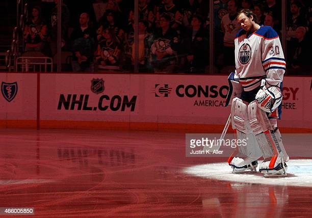 Ben Scrivens of the Edmonton Oilers stands during the National Anthem before the game against the Pittsburgh Penguins at Consol Energy Center on...