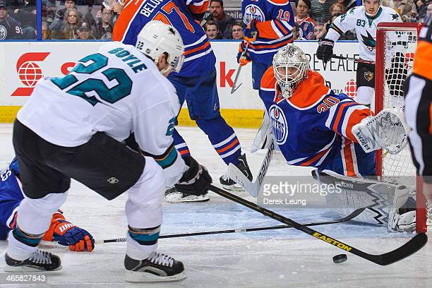 Ben Scrivens of the Edmonton Oilers stops the shot of Dan Boyle of the San Jose Sharks during an NHL game at Rexall Place on January 29 2014 in...