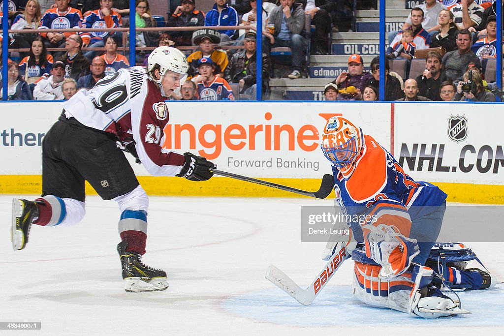 Ben Scrivens #30 of the Edmonton Oilers stops the shot of Nathan MacKinnon #29 of the Colorado Avalanche during an NHL game at Rexall Place on April 8, 2014 in Edmonton, Alberta, Canada. The Avalanche defeated the Oilers 4-1.