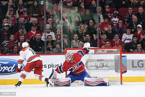Ben Scrivens of the Montreal Canadiens blocks a shot by Elias Lindholm of the Carolina Hurricanes in the NHL game at the Bell Centre on February 7...