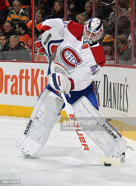 Ben Scrivens of the Montreal Canadiens looks to pass the puck against the Philadelphia Flyers on January 5 2016 at the Wells Fargo Center in...