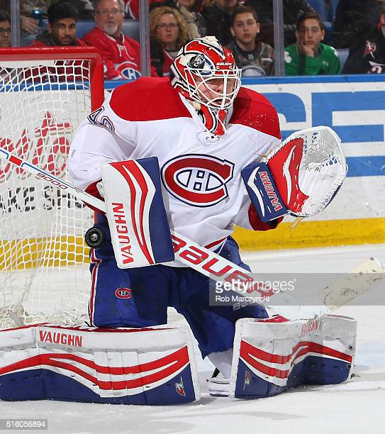 Ben Scrivens of the Montreal Canadiens makes an overtime save against the Buffalo Sabres on March 16 2016 at the First Niagara Center in Buffalo New...