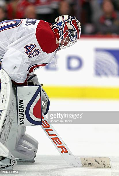 Ben Scrivens of the Montreal Canadiens takes a break during a timeout against the Chicago Blackhawks at the United Center on January 17 2016 in...