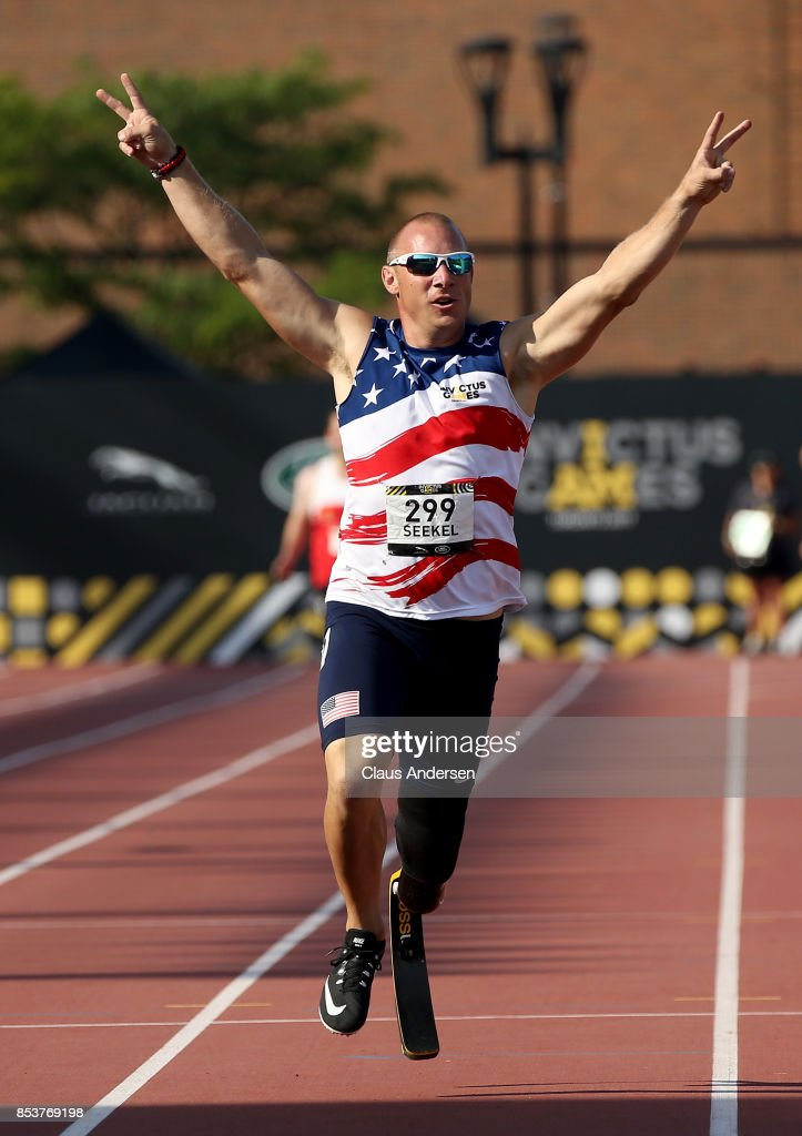 Ben Seekell of the United States celebrates after winning gold in the Men's IT1 400m Final during Day Three of the Invictus Games 2017 at York Lions Stadium on September 25, 2017 in Toronto, Canada