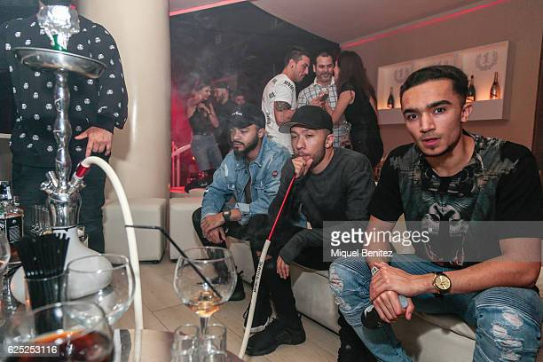 Ben Sharples, Michael Welch and Akia Jones smoke shisha from a hookah pipe during the 'Purpose Tour' Party, Justin Bieber's after concert at Pacha...