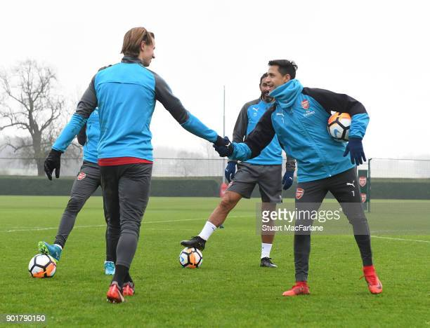Ben Sheaf and Alexis Sanchez of Arsenal during a training session at London Colney on January 6 2018 in St Albans England