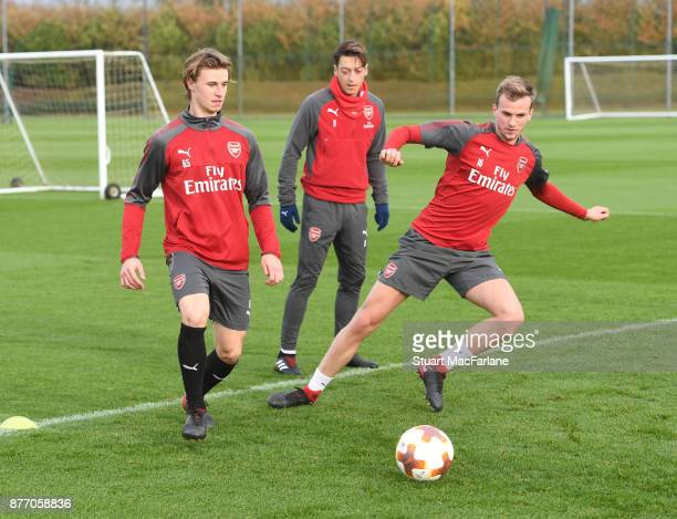 Ben Sheaf and Rob Holding of Arsenal during a training session at London Colney on November 21 2017 in St Albans England
