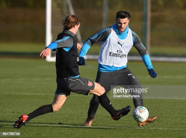 Ben Sheaf and Sead Kolasinac of Arsenal during a training session at London Colney on December 18 2017 in St Albans England