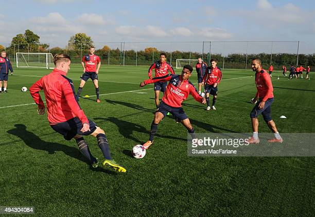 Ben Sheaf Marcus AgyeiTabi and Theo Walcott of Arsenal during a training session at London Colney on October 26 2015 in St Albans England