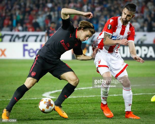Ben Sheaf of Arsenal in action against Damien Le Tallec of Crvena Zvezda during the UEFA Europa League group H match between Crvena Zvezda and...
