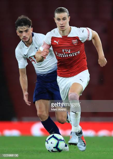 Ben Sheaf of Arsenal in action with Troy Parrott of Tottenham Hotspur during the Premier League 2 match between Arsenal and Tottenham Hotspur at...