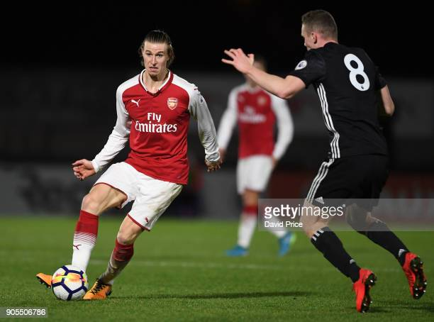 Ben Sheaf of Arsenal is closed down by Ethan Hamilton of Man Utd during the Premier League 2 match between Arsenal and Manchester United at Meadow...
