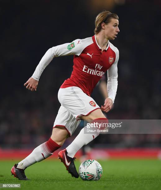 Ben Sheaf of Arsenal runs with the ball during the Carabao Cup quarter final match between Arsenal and West Ham United at Emirates Stadium on...
