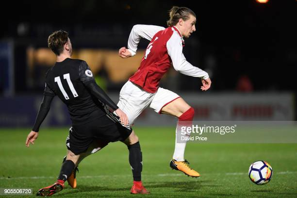 Ben Sheaf of Arsenal skips past Indy Boonew of Man Utd during the Premier League 2 match between Arsenal and Manchester United at Meadow Park on...