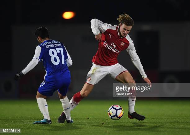 Ben Sheaf of Arsenal takes on Bruno Costa of Porto during the match between Arsenal U23 and Porto at Meadow Park on November 17 2017 in Borehamwood...