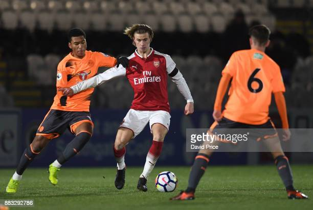 Ben Sheaf of Arsenal takes on Danny Loader of Reading during the Premier League International Cup match between Arsenal and Reading at Meadow Park on...