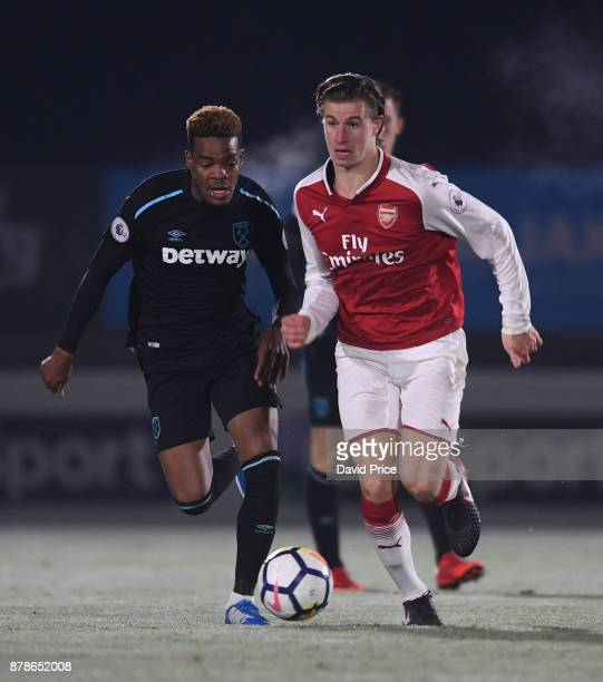 Ben Sheaf of Arsenal takes on Grady Diangana of West Ham during the Premier League Two match between Arsenal U23 and West Ham United U23 at Meadow...