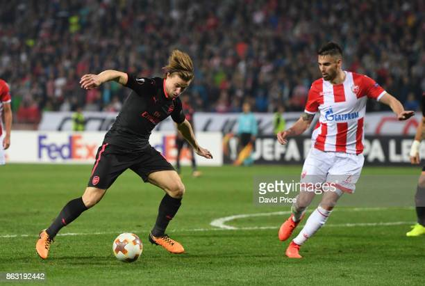 Ben Sheaf of Arsenal takes on Uros Racic of Red Star during the UEFA Europa League group H match between Crvena Zvezda and Arsenal FC at Rajko Mitic...