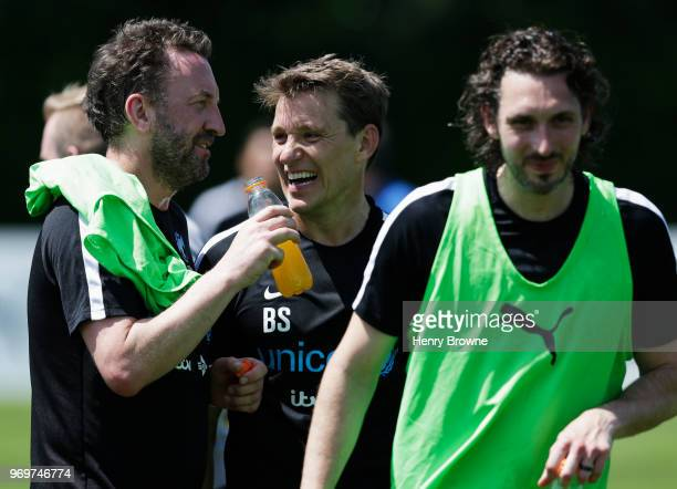 Ben Shephard assistant manager of England jokes with Lee Mack and Blake Harrison as they take part in training during Soccer Aid for UNICEF media...