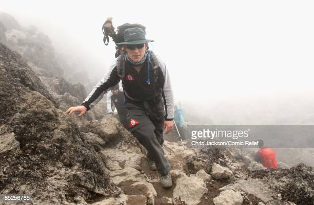 Ben Shephard treks into camp in the rain on the fifth day of The BT Red Nose Climb of Kilimanjaro on March 5 2009 in Arusha Tanzania Celebrities...