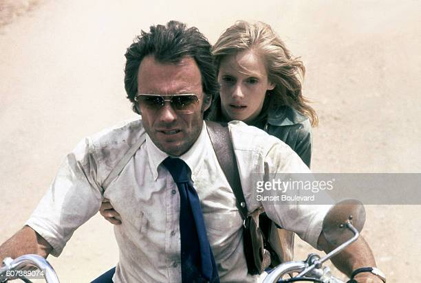 Ben Shockley played by Clint Eastwood and Gus Mally riding a motorcycle in a scene from Eastwood's action film 'The Gauntlet' 1977 Photo by Warner...