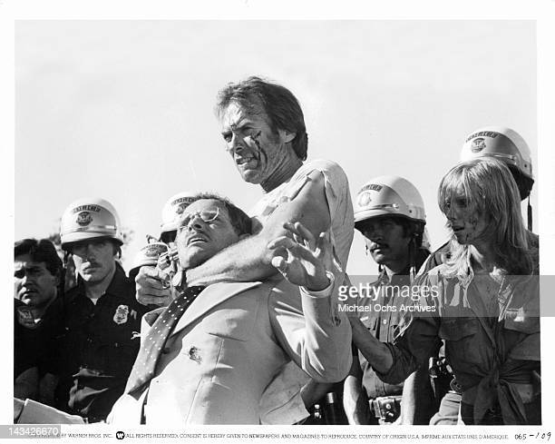 Ben Shockley played by Clint Eastwood holds Feyderspiel in a choke hold in a scene from Eastwood's action film 'The Gauntlet' 1977 On the right is...