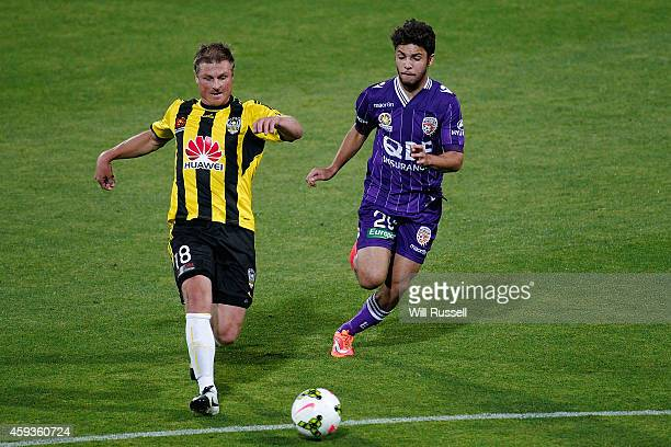 Ben Sigmund of the Phoenix and Daniel De Silva of the Glory vie for the ball during the round seven ALeague match between Perth Glory and Wellington...