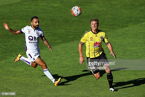Ben Sigmund of the Phoenix controls the ball under pressure from Diego Castro of the Glory during the round 24 ALeague match between the Wellington...