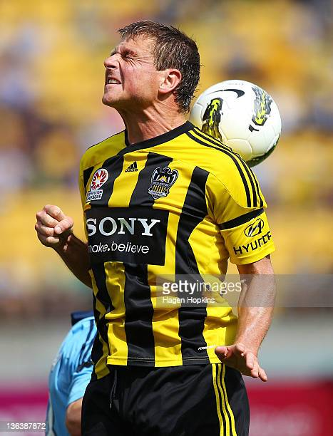 Ben Sigmund of the Phoenix heads the ball during the round 13 midweek ALeague match between Wellington Phoenix and Sydney FC at Westpac Stadium on...