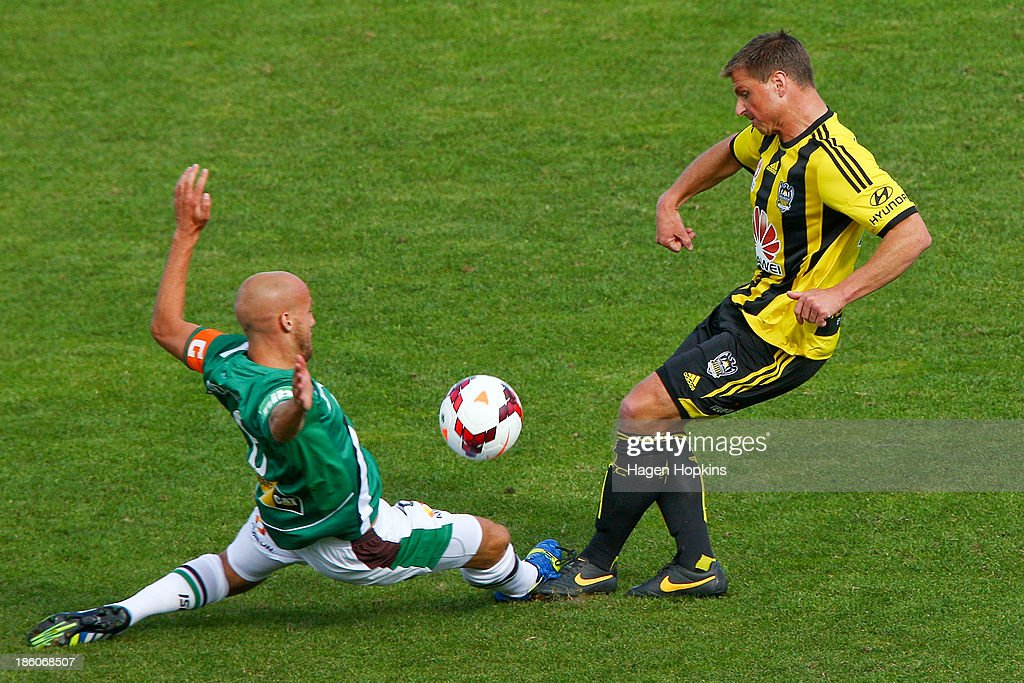 Ben Sigmund of the Phoenix is tackled by Ruben Zadkovich of the Jets during the round three A-League match between Wellington Phoenix and the Newcastle Jets at McLean Park on October 27, 2013 in Napier, New Zealand.