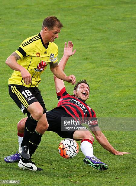 Ben Sigmund of the Phoenix tackles Brendon Santalab of the Wanderers during the round 27 ALeague match between the Wellington Phoenix and Western...