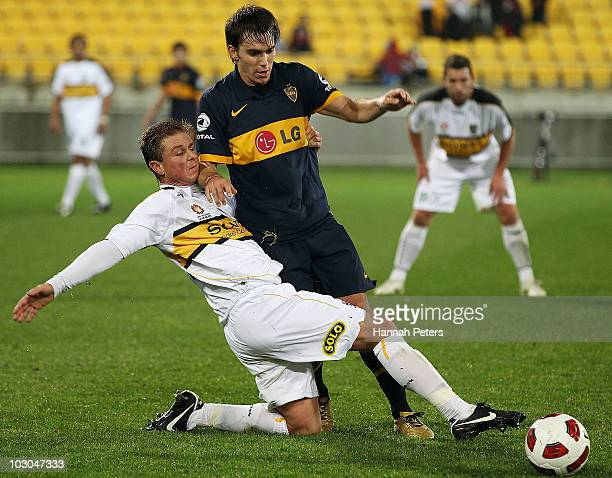 Ben Sigmund of the Phoenix tries to kick the ball past Pablo Mouche of the Boca Juniors during the pre-season friendly match between Wellington...