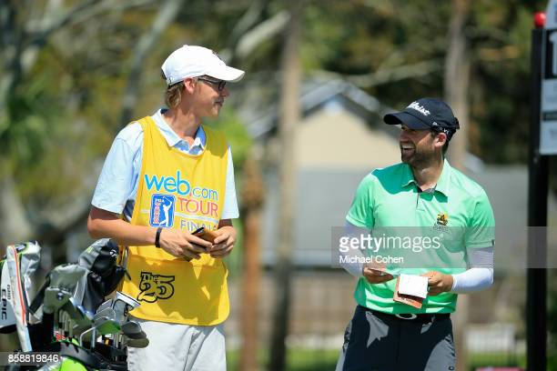 Ben Silverman has a laugh with his caddie during the first round of the Webcom Tour Championship held at Atlantic Beach Country Club on September 28...