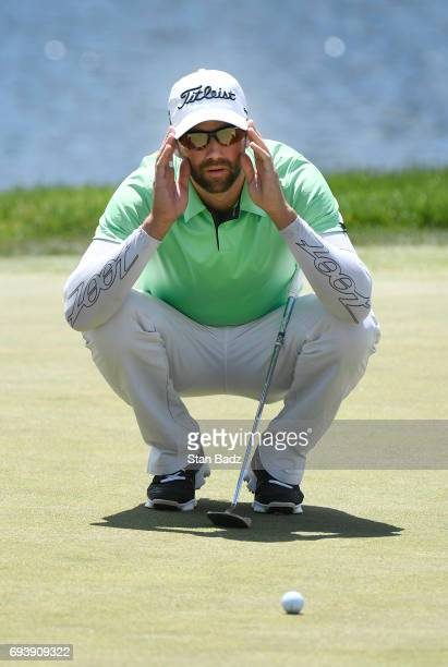 Ben Silverman studies his putt on the 18th hole during the first round of the Webcom Tour RustOleum Championship at Ivanhoe Club on June 8 2017 in...