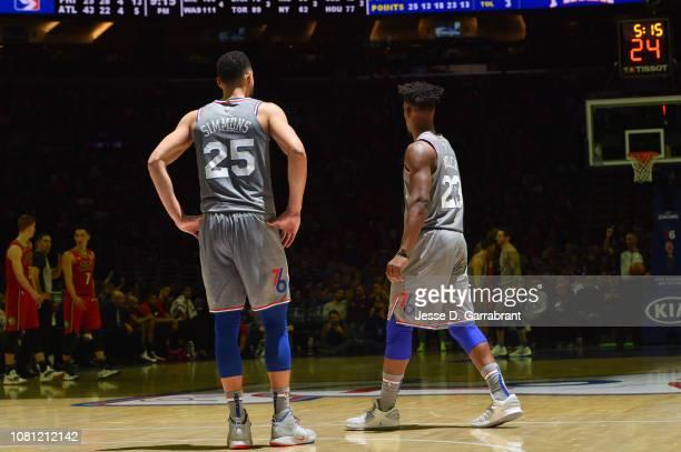 Ben Simmons and Jimmy Butler of the Philadelphia 76ers look on against the Atlanta Hawks on January 11 2019 at the Wells Fargo Center in Philadelphia...