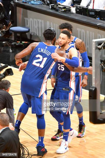 Ben Simmons and Joel Embiid of the Philadelphia 76ers hug during the game against the Miami Heat in Game Four of Round One of the 2018 NBA Playoffs...