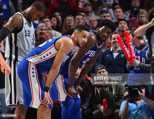 Ben Simmons and Joel Embiid of the Philadelphia 76ers look on during a foul shot against the San Antonio Spurs at Wells Fargo Center on January 3...