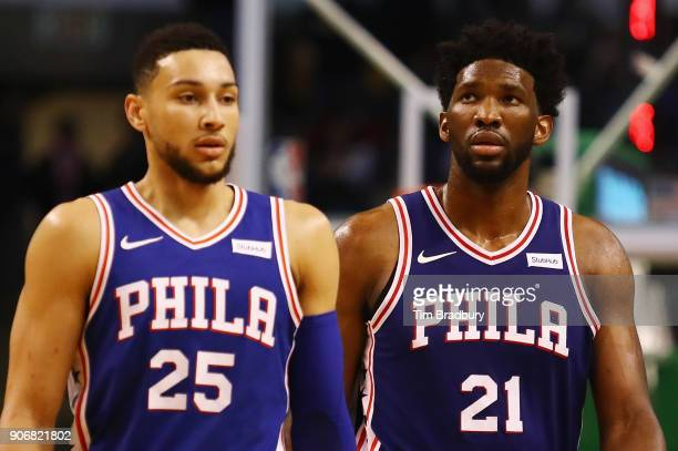 Ben Simmons and Joel Embiid of the Philadelphia 76ers walk off the court during a time out in the second half against the Boston Celtics at TD Garden...