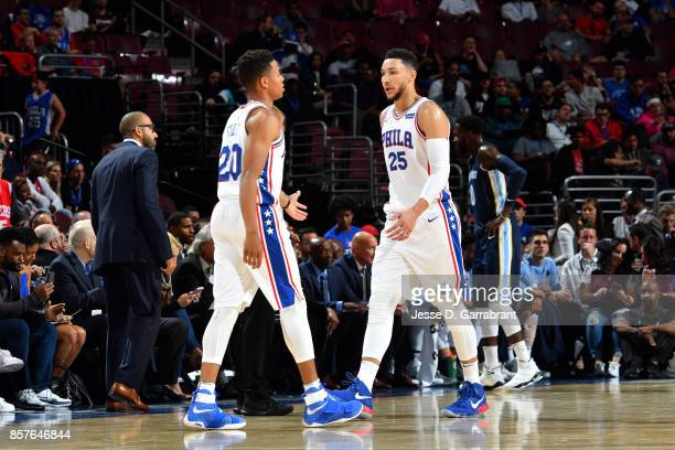 Ben Simmons and Markelle Fultz of the Philadelphia 76ers go to high five each other during the game against the Memphis Grizzlies during a preseason...