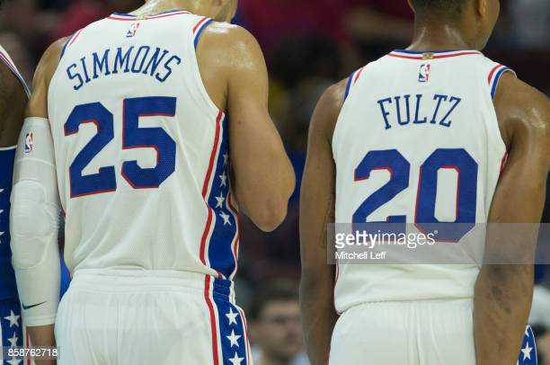 Ben Simmons and Markelle Fultz of the Philadelphia 76ers play against the Memphis Grizzlies during the preseason game at the Wells Fargo Center on...