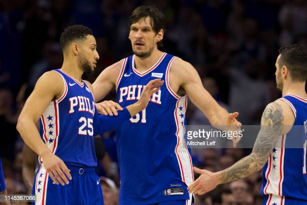 Ben Simmons Boban Marjanovic and JJ Redick of the Philadelphia 76ers react against the Brooklyn Nets in Game Five of Round One of the 2019 NBA...