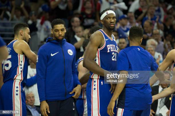 Ben Simmons Jahlil Okafor Joel Embiid and Markelle Fultz of the Philadelphia 76ers look on from the bench during a timeout against the Boston Celtics...