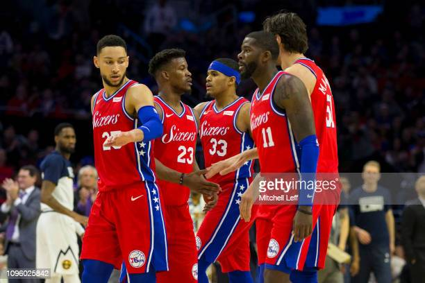 Ben Simmons Jimmy Butler Tobias Harris James Ennis and Boban Marjanovic of the Philadelphia 76ers congratulate one another after a timeout in the...