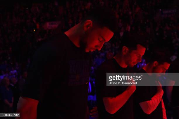 Ben Simmons JJ Redick and TJ McConnell of the Philadelphia 76ers stands for the National Anthem before the game against the Miami Heat on February 2...