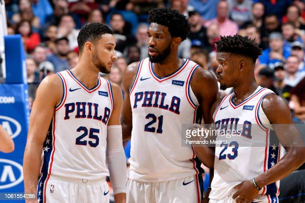 Ben Simmons Joel Embiid and Jimmy Butler of the Philadelphia 76ers talk during the game against the Orlando Magic on November 14 2018 at Amway Center...