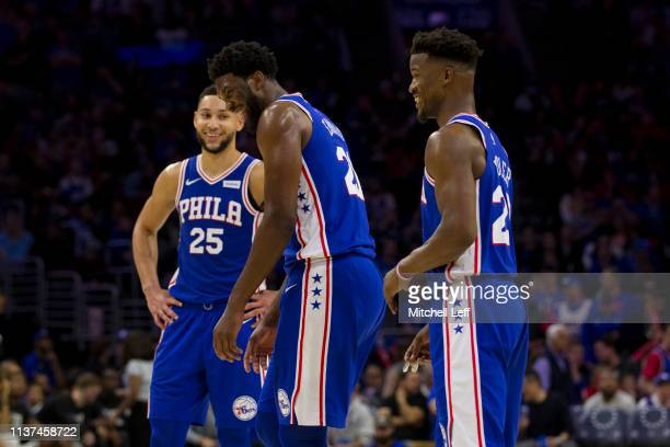 Ben Simmons Joel Embiid and Jimmy Butler of the Philadelphia 76ers react during action against the Brooklyn Nets in the third quarter of Game Two of...